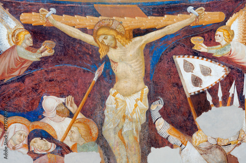 COMO, ITALY - MAY 9, 2015: The old fresco of Crucifiction in church Basilica di San Abbondio by unknown artist
