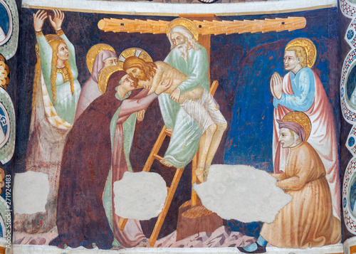 COMO, ITALY - MAY 9, 2015: The old fresco of Deposition in church Basilica di San Abbondio by unknown artist