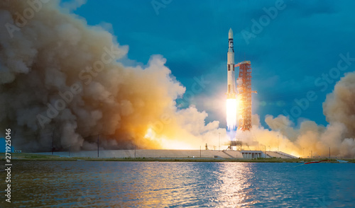 Rocket takes off into the sky Canvas Print