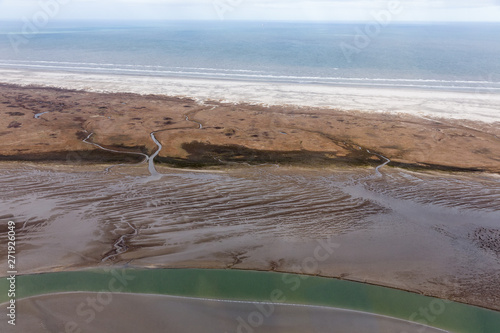 Aerial view Dutch island Schiermoniikoog, coastline with wetlands and channels Fototapeta