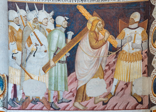 COMO, ITALY - MAY 9, 2015: The old fresco of Jesus with the cross in church Basilica di San Abbondio by unknown artist