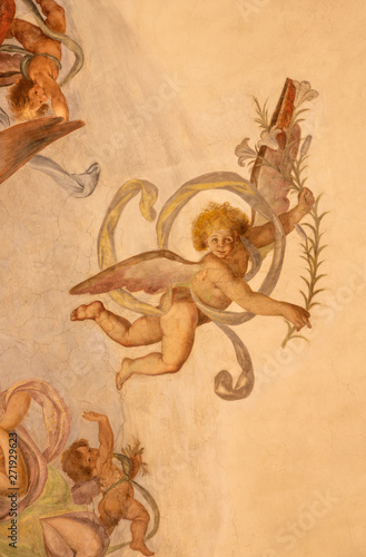 COMO, ITALY - MAY 11, 2015: The detail of baroque fresco of angels with the instruments of martyrium in church Chiesa di San Orsola Gian Domenico Caresana (1616).