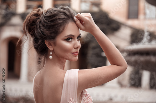 Canvas Print Beautiful bride with pearl earrings jewelry wears pink prom dress