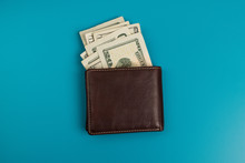 Male Wallet With Banknotes Studio Image. Leather Wallet With Dollar Bills.