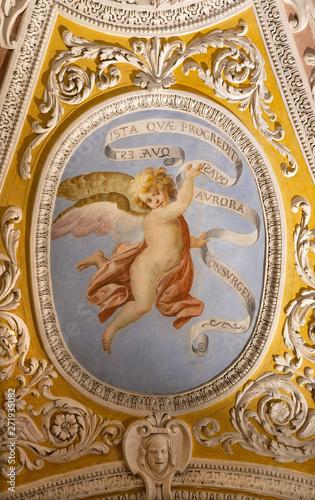OSSUCCIO, ITALY - MAY 8, 2015: The baroque fresco of angel with the mariological inscriptions in church Sacro Monte della Beata Vergine del Soccorso by Salvatore Pozzi di Puria (1595 – 1681).
