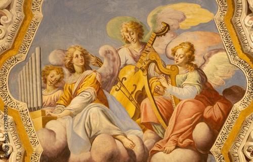 OSSUCCIO, ITALY - MAY 8, 2015: The baroque fresco choir of angels with the music instruments in church Sacro Monte della Beata Vergine del Soccorso by Salvatore Pozzi di Puria (1595 – 1681).