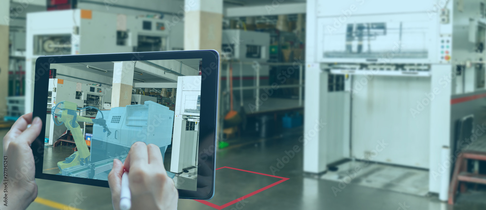 Fototapeta smart manufacturing ,industry 4.0, 5.0 technology concept, man use augmented mixed virtual reality technology to manage and simultion to install new machine in the factory predict, analytic how to fit