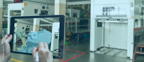 smart manufacturing ,industry 4.0, 5.0 technology concept, man use augmented mixed virtual reality technology to manage and simultion to install new machine in the factory predict, analytic how to fit