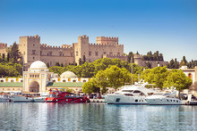 Rhodes Old Fortress Cityscape With Sea Port At Foreground. Travel Destinations In Greece