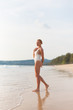 Model on the beach in white dress