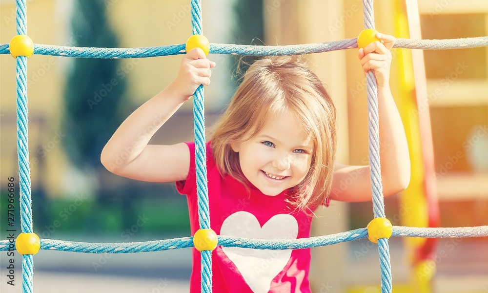 Fototapety, obrazy: Girl playing on playground in city park