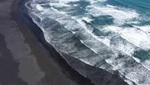 Aerial Drone View Of Waves Rushing To The Shore On Black Volcanic Sand. Atlantic Ocean, Iceland