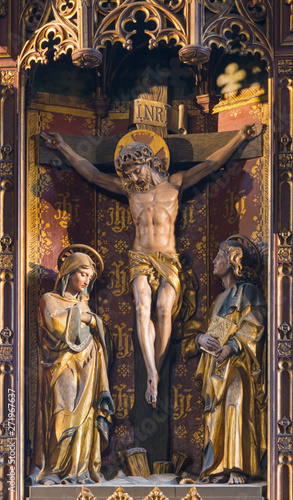 LONDON, GREAT BRITAIN - SEPTEMBER 17, 2017: The carved Crucifixion on the main altar in church St. Barnabas designed probably by Ninian Comper (20. cent.).
