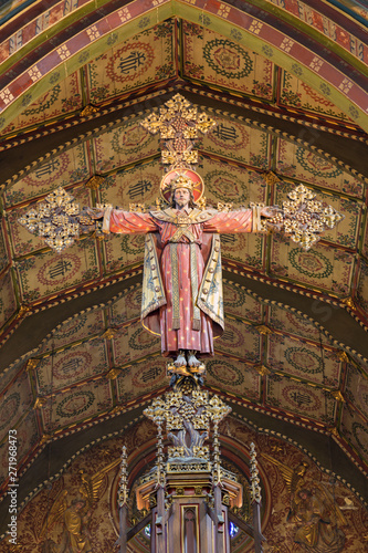 LONDON, GREAT BRITAIN - SEPTEMBER 17, 2017: The carved Crucifixion of Jeus as the king and priest in church St. Barnabas designed by Bodley in 1906.