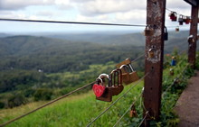 Maleny, Australia - Apr 25, 2019. Couples Showing Their Everlasting Love (Love You Forever) By Attaching A Coloured Padlock To The Gerrards Lookout Iron Fence Of The  As A Token Of Love.