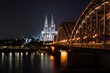 Cologne Dom with Hohenzollernbridge in night