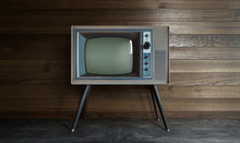 Vintage Retro Television On A Wooden Wall Background .