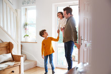 Single Father Returning Home After Trip Out With Excited Children Running Ahead