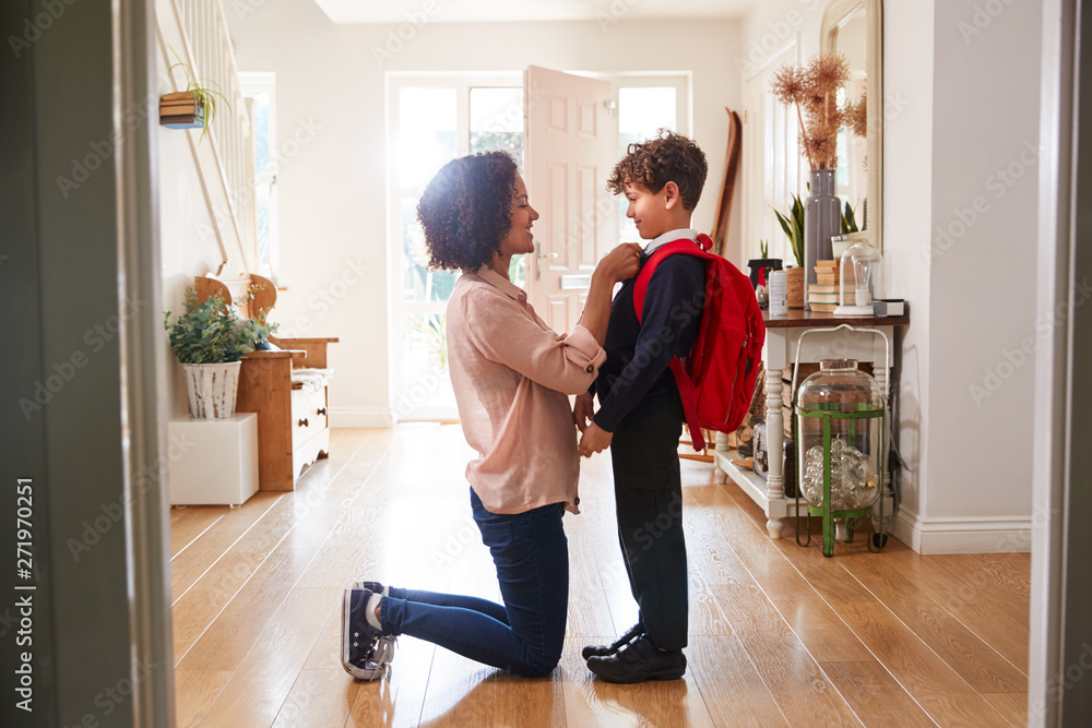 Fototapety, obrazy: Single Mother At Home Getting Son Wearing Uniform Ready For First Day Of School