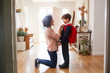 Leinwanddruck Bild - Single Mother At Home Getting Son Wearing Uniform Ready For First Day Of School