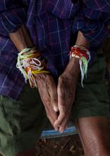 Man With Baci Strings Bracelet...