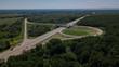 Aerial view of highway cloverleaf interchange seen from above.