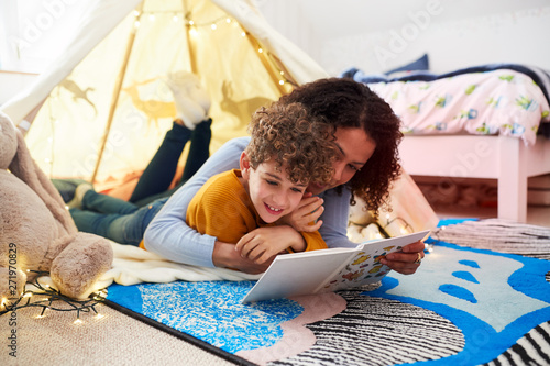 Valokuva Single Mother Reading With Son In Den In Bedroom At Home