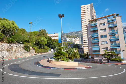 Poster F1 Monte Carlo street curve with formula one red and white signs in a sunny summer day in Monte Carlo, Monaco