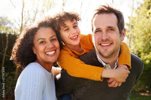 Obraz Outdoor Portrait Of Smiling Family In Garden At Home Against Flaring Sun - fototapety do salonu