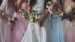 canvas print picture Bride and bridesmaids. Beautiful young women in dresses