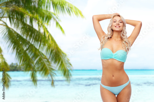 Obraz na płótnie summer holidays, vacation and travel concept - young woman posing in bikini over