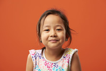 Bright Portrait Of Asian Girl