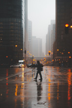 Silhouette Of A Man Crossing The Street On A Foggy Evening, Chicago, Illinois, United States