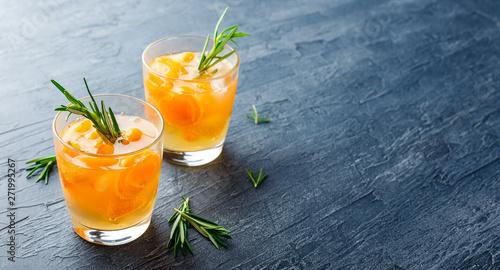 Fotografie, Obraz  Summer drinks, rosemary aprcot cocktails.