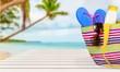 Leinwandbild Motiv Bag,  flip flops on a tropical beach