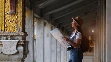 Beautiful Young Girl Tourist At Chaimongkol Pagoda Roiet (Watchaimongkol) Famous Landmark At Roi-et Thailand.