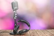 canvas print picture - Retro style microphone and headphones on  background