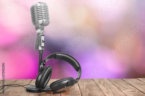 Retro style microphone and headphones on  background - 272002286