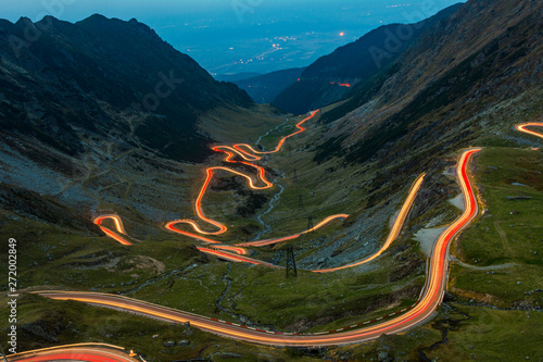 Photo Stands Black Traffic trails on Transfagarasan pass,rossing Carpathian mountains in Romania, Transfagarasan is one of the most spectacular mountain roads in the world.