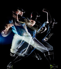 One Caucasian Baseball Player Man  Studio Shot Isolated On Black Background With Light Painting Speed Effect