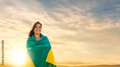 Obraz na plátně  Woman with brazilian flag, brazilian fan