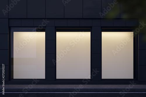 Fotografia Three mock up posters in shop window at night