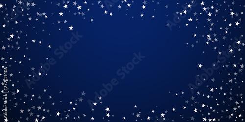 Fototapeta Random falling stars Christmas background. Subtle flying snow flakes and stars on dark blue night background.  obraz na płótnie