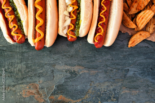 Hot dogs with toppings and potato wedges Canvas Print