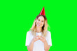canvas print picture - Young Caucasian girl smiles while she holds a birthday cupcake and wearing a birthday hat