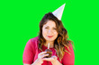 canvas print picture - Smiling woman holds a birthday cupcake on green screen