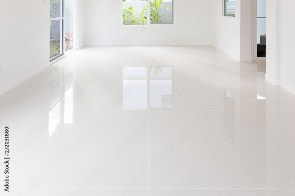 Fototapeta White tile floor background in perspective view. Clean, shiny, symmetry with grid line texture. For decoration in bathroom, kitchen and laundry room. And empty or copy space for product display also.