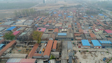 Small Rural Poor Villages, Surrounded By Farm Land, Small Factories And Train Tracks Outside Beijing During Extreme Pollution Gray Day. China.