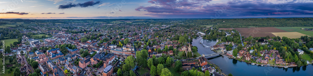 Fototapety, obrazy: Dramatic aerial panoramic view of the beautiful town of Marlow in Buckinghamshire UK, captured after a rain storm at dusk