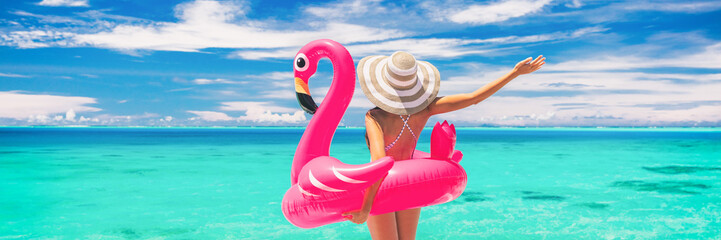 Happy summer vacation fun woman tourist enjoying travel holidays on beach banner background ready for swimming pool with flamingo float - funny holiday concept.